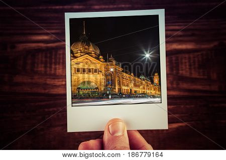 Hand Holding Polaroid Postcard Of Flinders Street Station At Night. Melbourne, Australia. Travel Mem