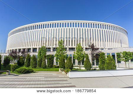 Krasnodar, Russia - May 10, 2016: Park green trees in front of the new stadium of FC Krasnodar on May 10, 2017