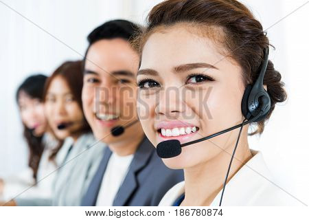 Smiling call center team - customer service telemarketer and operator concepts