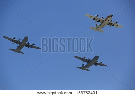 BEER SHEBA, ISRAEL - MAY 2, 2017: C-130 Hercules (front) and C-130J Super Hercules military transport aircraft during Israel's Annual Independence Day Air Force Flyover in Beer Sheba