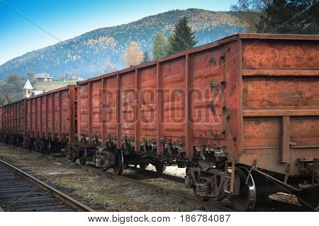 Wagons of a freight train on the railway in the mountains. Container train.
