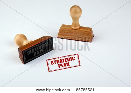 Strategic Plan. Rubber Stamper with Wooden handle Isolated on White Background.