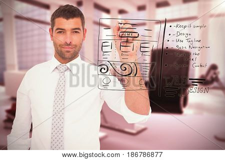 Confident male executive writing with marker against computer generated image of workplace