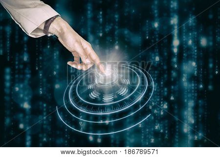 Businesswoman using imaginative digital screen against digital composite of volume knob with light trails