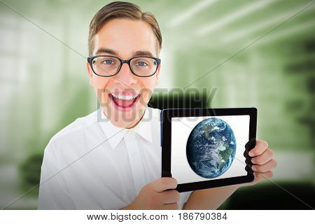 Geeky businessman showing his tablet pc against digital image of workplace