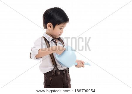 Cute Asian child holding blue watering on white background isolated