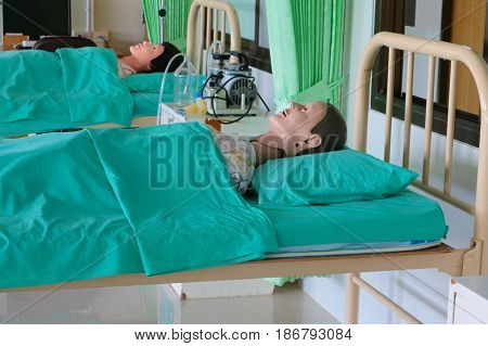 Medical dummy in hospital training Medical course education on bed and blanket green