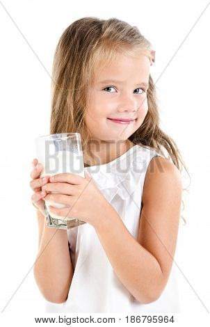 Smiling little girl drinking milk isolated on a white background