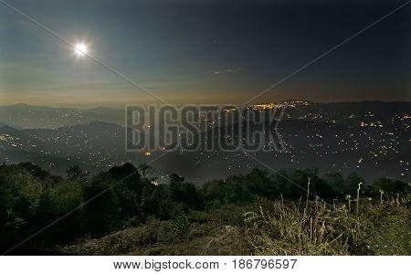 Beautiful night image of Darjeeling under full moon Queen of Hills as seen from Okhrey Sikkim India