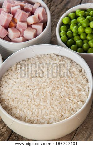 raw ingredients for risotto close up on wood