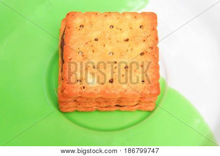 cookies bread square macro focus in the plate on old wooden floor background