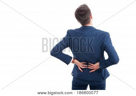 Rear View Of Salesman Suffering From Backache