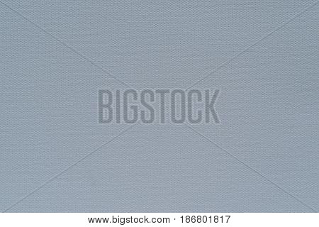 abstract grained texture of speckled fabric or paper material of pale color