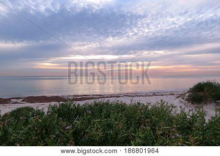 Semaphore beach South Australia sunlight sunset light over the beach and sea jetty