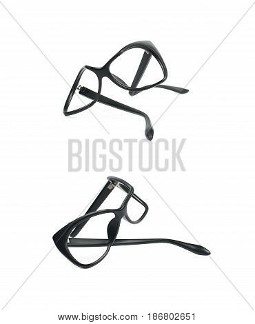Heavily broken, bent and deformed pair of black plastic sight glasses isolated over the white background, set of two different foreshortenings