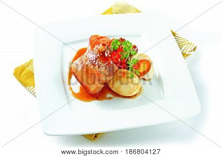 Vietnamese Simmered Meat With Egg On White Platter