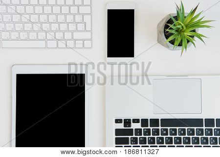 Top View Of Laptops With Digital Tablet And Smartphone On Table Top. Laptop Tablet
