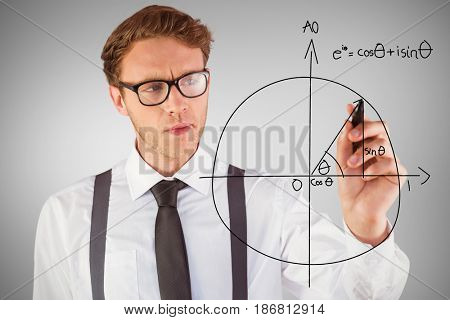 Geeky businessman writing with marker against grey vignette