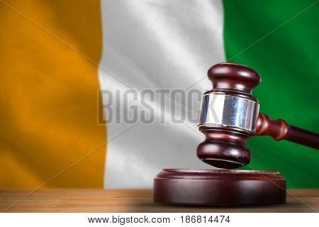 Hammer and gavel against 3d ivory coast national flag