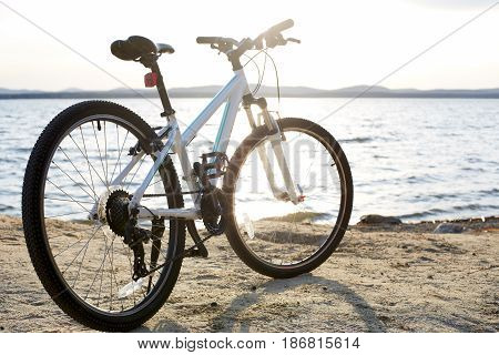 Bicycle in nature landscape. A bicycle stands alone by the lake
