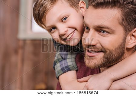 young father with little son sitting on porch at backyard dad and son playing