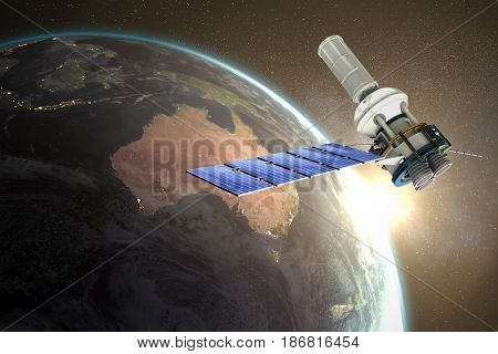3d image of modern solar satellite against aerial view of the earth
