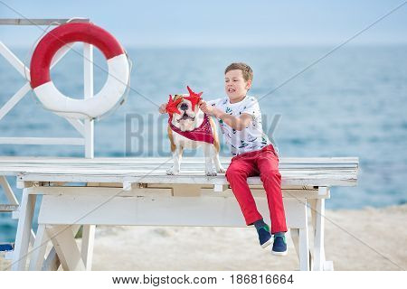 Handsome Boy Teen Happyly Spending Time Together With His Friend Bulldog On Sea Side Kid Dog Holding