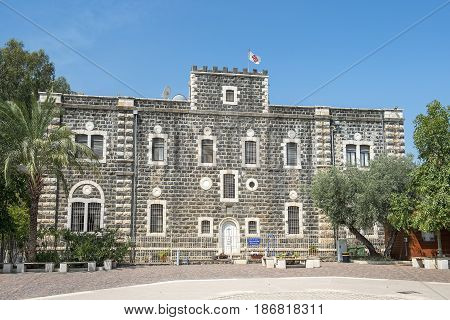 Capernaum, Israel - April 01, 2017 : The main entrance and forecourt of Catholic Franciscan monastery building, built in 1894 in Capernaum (Cafarnaum). near Tiberias, Sea of Galilee, Israel