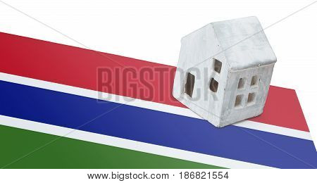Small House On A Flag - Gambia