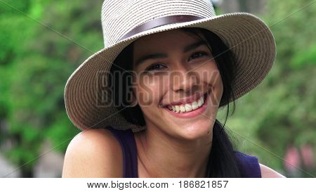 Hispanic Youthful Girl Teenager Wearing a Hat