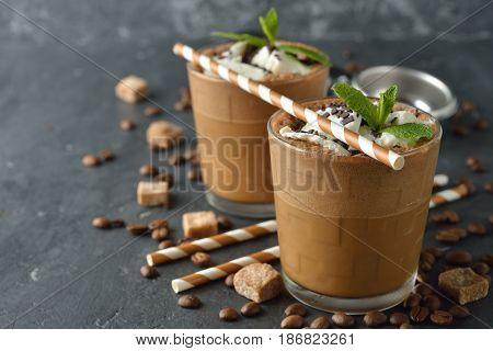Milkshake with coffee and ice cream on a gray background