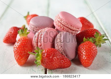 Macaroon with strawberries on a white background