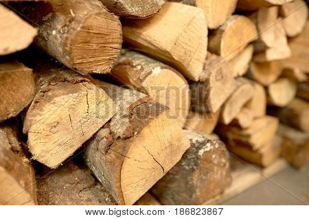 stove heating and wood fuel concept - close up of firewood