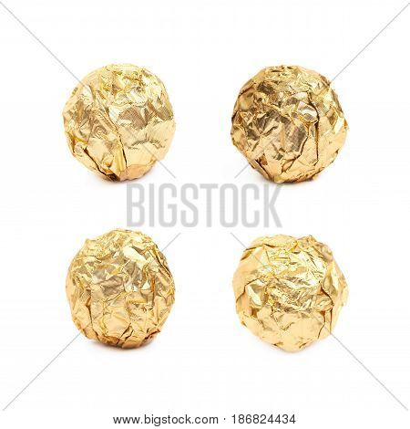 Ball confection candy in a golden foil wrapper isolated over the white background, set of four different foreshortenings