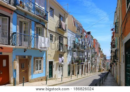 The typical streets of old Lisbon in the Alfama district on a sunny summer day Portugal