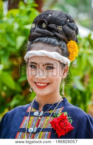 NAKORN PHANOM THAILAND - FEBRUARY 14 2015: Thai northeastern dancer with traditional costume in Phutai world event day in Renunakorn of Nakorn Phanom Thailand