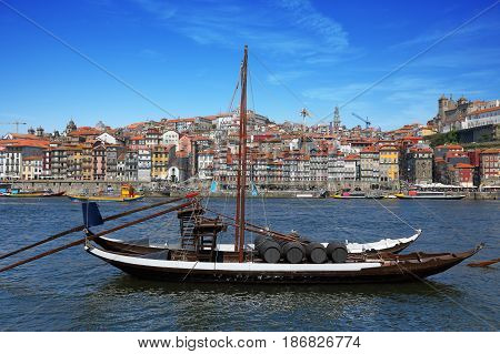 Traditional Portuguese boat for transporting barrels of port wine in Porto Portugal