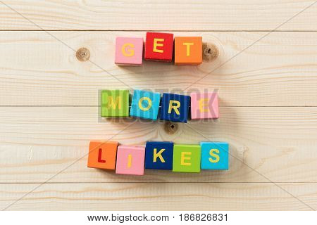 Top View Of Colorful Cubes With Text Get More Likes