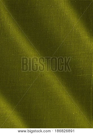 Fabric, fabric texture. Yellow fabric texture. Yellow background. Yellow textile. Olive fabric, olive background.