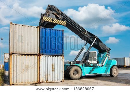 Heavy lifting truck at the container logistic yard.