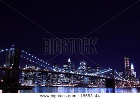 New York City Skyline and Brooklyn Bridge At Night