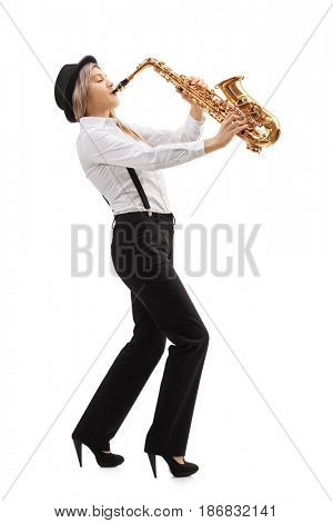 Full length profile shot of a female jazz musician playing a saxophone isolated on white background