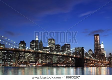 New York City Skyline and Brooklyn Bridge At Night