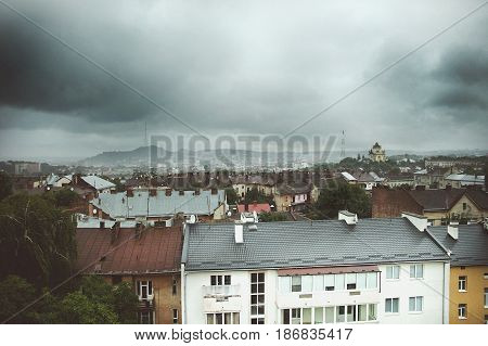 Rain clouds cover the old city buildings