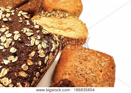 Fresh black bread and bread roll on a white background