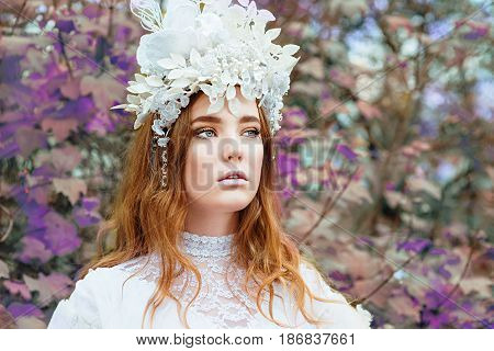 portrait of red hair (ginger) beautiful young girl snow princess in a crown