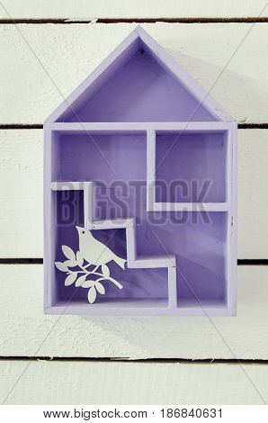 House interior decoration using little wooden levender house with bird on white background.