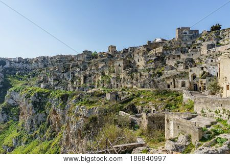 beautiful ancient ghost town of Matera (Sassi di Matera) in beautiful bright sun shine with blue sky south Italy.