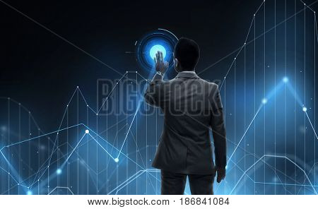business, statistics, people and technology concept - businessman working with virtual chart projection from back over black background