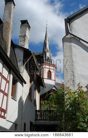 historic church spire and houses in Ediger Mosel Germany